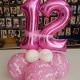 composizione-centrotavola-compleanno-12-anni-bambina-rosa---mazzucchellis